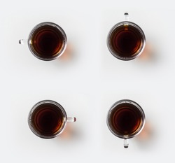 Top view of glass cup of hot black tea on white background desk for mockup, collection of diverse angle.