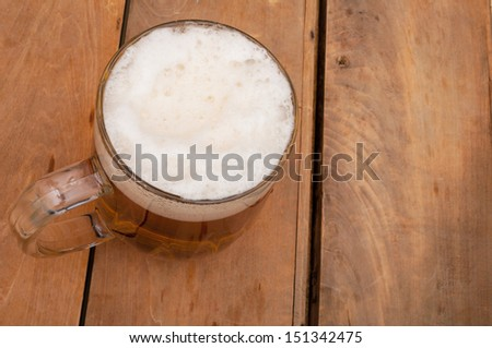 Top View of Glass Full of Beer on Aged Wooden Table