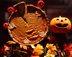 Top View of Gluten Free Pumpkin Pie with Autumn and Halloween Decorations. Fall Vibes with Orange Warm Colors.