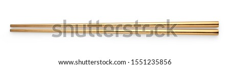 Top view of Golden chopsticks isolated on white background Stock photo ©