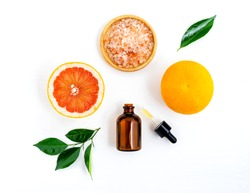 Top view of grapefruit, salt and dropper on white wooden table background in concept pure grapefruit extract.Vitamin C,full flavoured,ingredient for food,drinks and spa product.Best natural skin care.