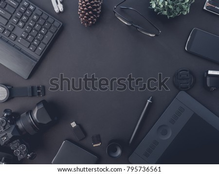 top view of graphic design and photographer concept with digital camera, memory card, smartphone, graphic tablet, and keyboard on black background with copy space #795736561