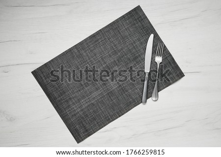 Top view of gray placemat table mat with knife and fork on white wooden table Stock photo ©