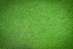 Top view of green artificial grass texture and background. Artificial turf grass for decorative in the garden, football field and golf course. Green backdrop and wallpaper. Copy space for your text.