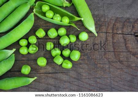 Top view of green peas, pods open and closed and individual peas. Close up. with empty place for text.