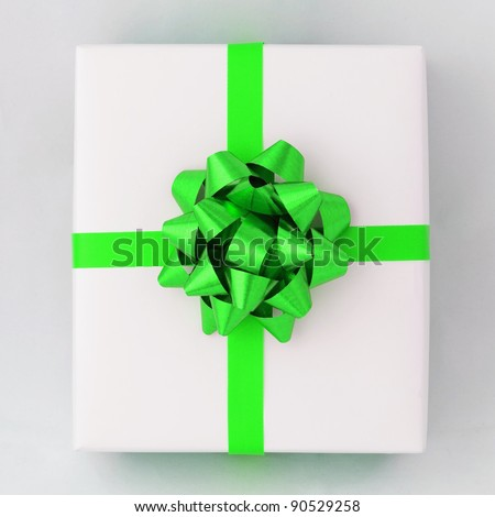 Top view of Green star and Cross line ribbon on White paper box, Gift for Special Day