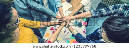 Top view of Group Of Asian and Multiethnic Business people making pile of hands in the modern office, people business teamwork group concept, Banner and web page or cover template  #1235999968