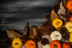 Top view of Halloween day and Thanksgiving day, Pumpkin, Knitting sweater, pine cone on dark background with copy space for text. Halloween concept, Thanksgiving concepts.