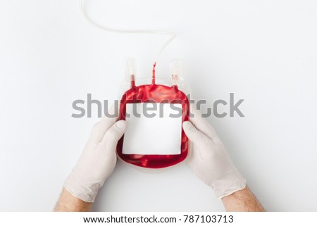 top view of hands in gloves holding blood for transfusion isolated on white background    #787103713