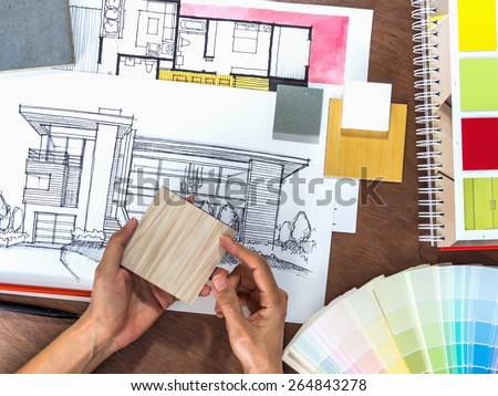 Top view of hands working with architecture hand-drawn sketch on creative workspace - Shutterstock ID 264843278