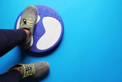 Top view of Healthy Lifestyle concept, Waist twisting disc on yoga mat.