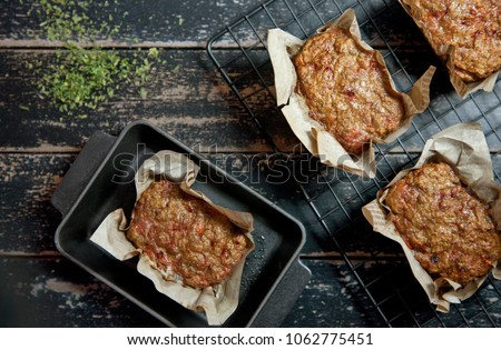 Top View of Homemade Roasted Meat Loafs on black rustic wooden table