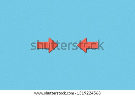 top view of horizontal opposite red pointers on blue background #1319224568