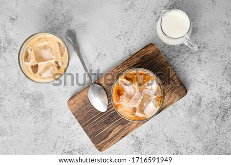 Top view of iced coffee with fat cream in rocks glass