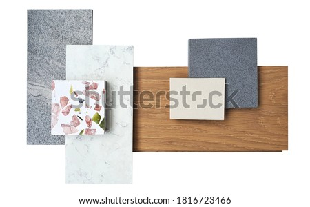 top view of interior material board. combination of white marble ,grey slate stone ,terazzo stone ,grey and beige artificial stone ,engineer wood flooring samples isolated on white background.
