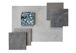 top view of interior material board contain concrete laminate ,stone tiles , grey marble tile and green terrazzo samples isolated on white background with clipping path.
