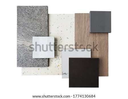 top view of interior material samples contains grey concrte tile ,black and white marble ,synthesis stone ,white terrazzo and wooden veneer isolated on white background with clipping path.