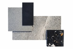 top view of interior material samples contains grey emperado tile ,grey concrete tile ,black terrazzo and black quartz sample isolated on white background with clipping path.