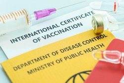 Top view of international certificate of vaccination, a record proving a traveller or someone has received certain vaccines. A document attesting that its bearer is immune to a contagious disease.
