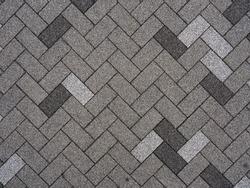 Top view of Japan footpath tiles. - Gray brick arranged in same pattern - diagonal view.