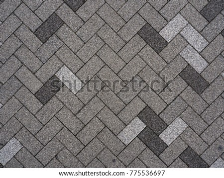 Top view of Japan footpath tiles. - Gray brick arranged in same pattern - diagonal view.