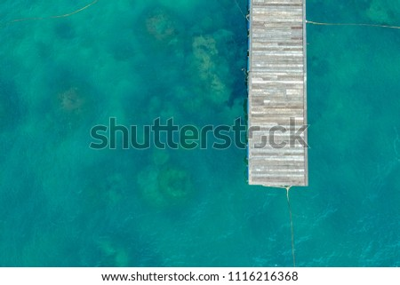 Top view of jetty with clear sea water