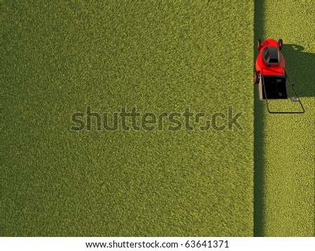 Top view of lawn mower on green field