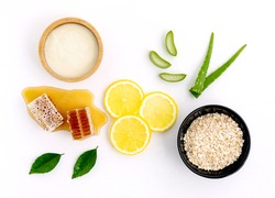 top view of lemon oats yogurt,aloe vera and honey on white wooden background.Best and easiest for DIY facial masks.Homemade spa product for acne scar face,body scrub for radiant and glow skin.
