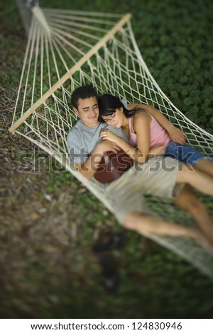 Top view of loving couple relaxing in hammock