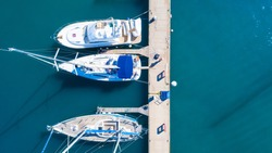 Top view of luxury yachts in the harbor, aerial shoot with drone. Concept of tourism and recreation