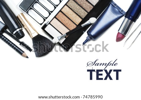 Top view of makeup set with white copyspace