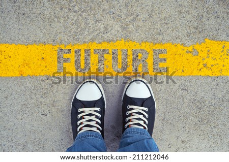 Top View of Male sneakers on the asphalt road with yellow line and title Future, Step into the future.