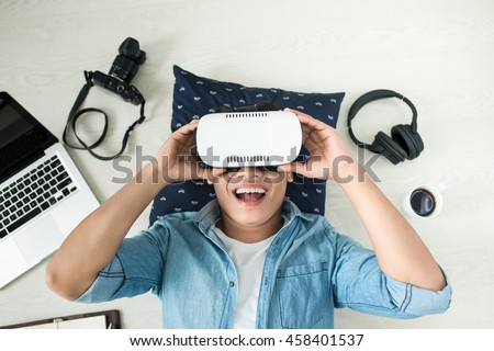 Top view of Man wearing virtual reality goggles