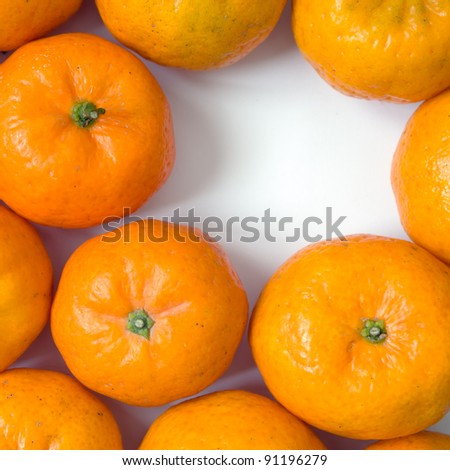 Top view of many orange on white table and space