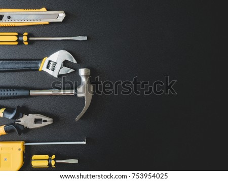 top view of Mechanic tools set on black background with copy space.