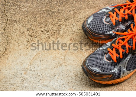 Top view of men's running shoes on a street #505031401