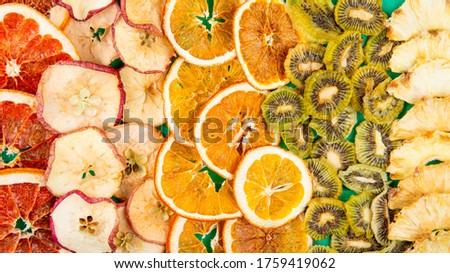top view of mix of dried fruits and citruses slices apple orange kiwi and pineapple background of dried fruits and citruses