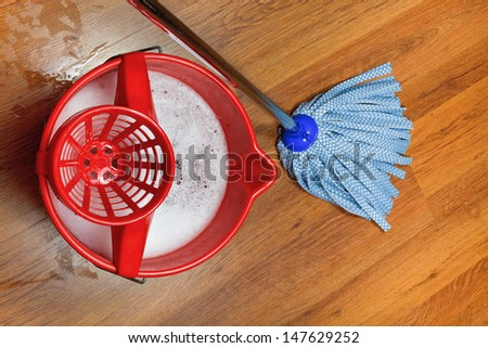 top view of mop and bucket with water for washing floors