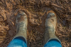 Top View of Muddy Wellington Boots in a Farmer's Field in Scotland