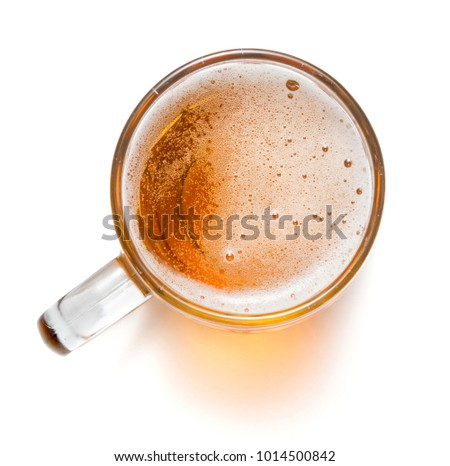 top view of mug with beer isolated on white background