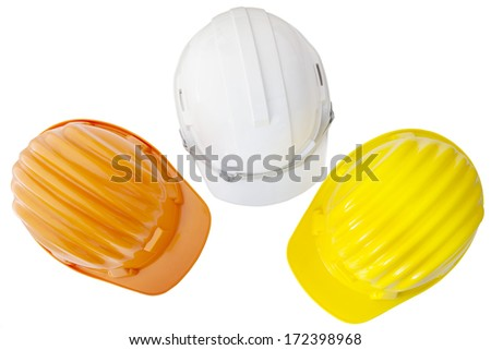 top view of multicolor safety, construction protection helmet  isolated white background