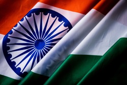 Top view of National Flag of India on wooden background. Indian Independence Day.