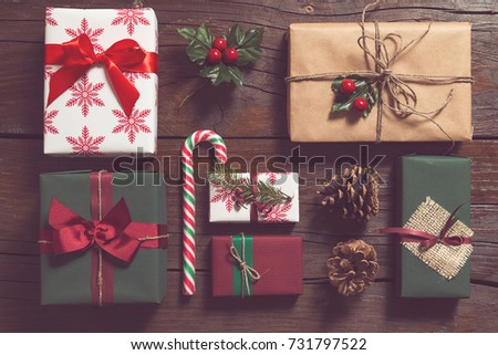 Top view of nicely wrapped Christmas presents laid on the wooden table #731797522