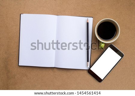 Top view of notebook,smartphone,pencil and cup of coffee on wood table background.Business desk minimal style concept with copy space for any design.Take note of the product for book with paper. #1454561414