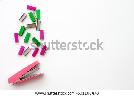 Top view of office accessories, pink stapler and colorful of staples with space for your design image or text