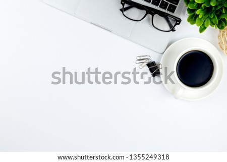 Top view of Office desk with workspace in office with blank notebook and other office supplies,with copy space. #1355249318
