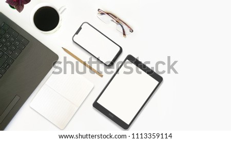 Top View of Office Desktop With Laptop, Mobile Phone, Tablet PC, Notebook, Glasses, Pencil and Coffee #1113359114