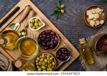 Top view of olives and olive oil bottles on table in a rustic kitchen Stock photo ©
