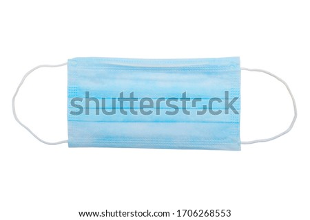 Top view of one surgical disposable face mask PP 3-ply with earloop isolated on white background - used in COVID-19 global pandemic of coronavirus SARS-CoV-2