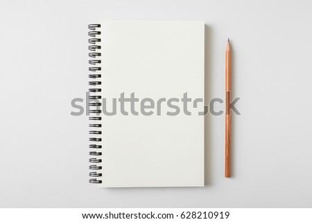 Top view of open spiral blank notebook with wood pencil on white desk background #628210919